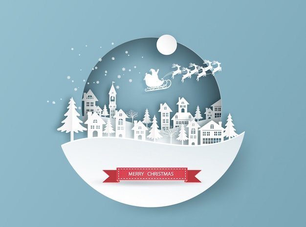 Carte De Joyeux Noël Dans Le Paysage D'hiver Avec Des Maisons Et Des Bâtiments Et Le Père Noël Sur Le Ciel Vecteur Premium