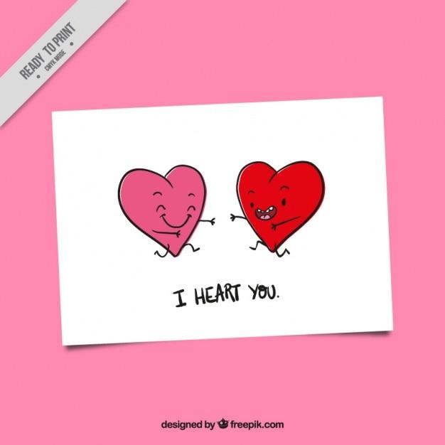La carte de la saint-valentin avec des coeurs souriants Vecteur gratuit