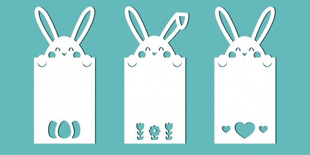 Cartes de pâques avec des lapins. un ensemble de modèles pour la découpe du papier, la découpe au laser ou le traceur. Vecteur Premium