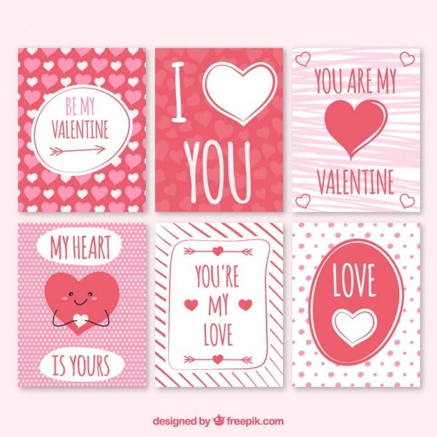 Les cartes de rouge et le blanc belle valentine Vecteur gratuit