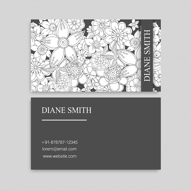 Cartes de visite de fleurs blanches et noires Vecteur gratuit