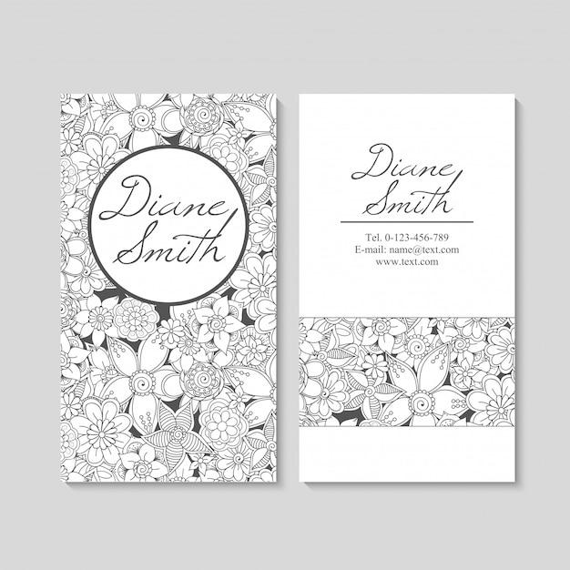 Cartes de visite de fleurs blanches et noires Vecteur Premium