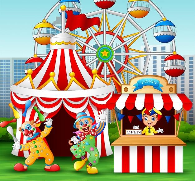 Cartoon clown montre une performance acrobatique à l'amusement Vecteur Premium