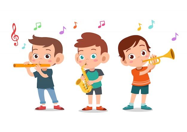 Cartoon petits enfants jouant de la musique Vecteur Premium