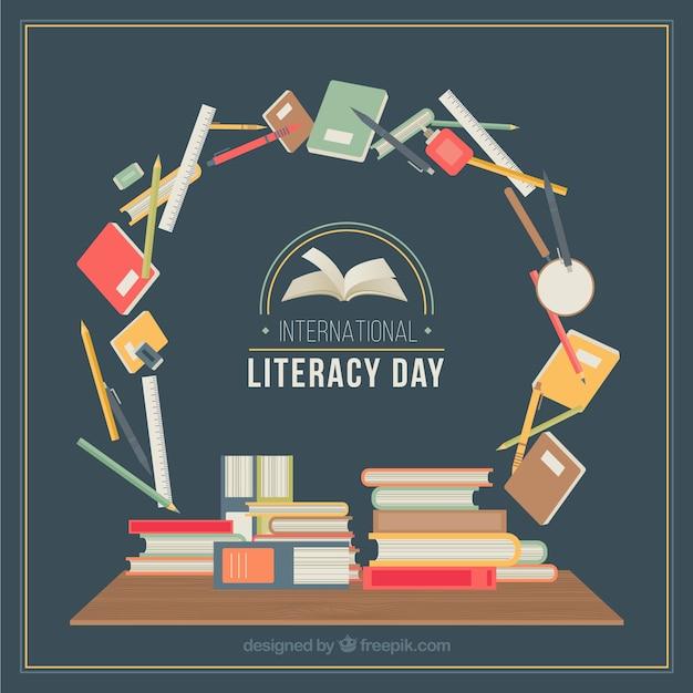 Cercle avec des articles scolaires pour la journée de l'alphabétisation Vecteur gratuit