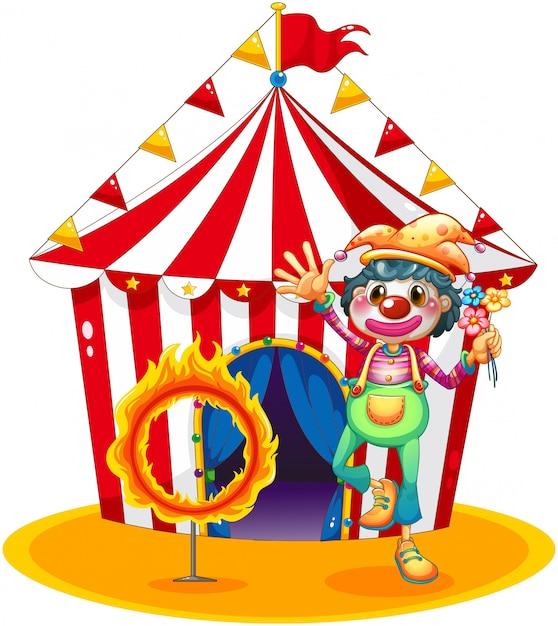 Un Cercle De Feu Et Un Clown Devant Une Tente De Cirque Vecteur gratuit