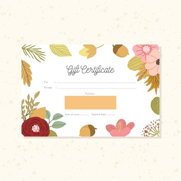 Certificat-cadeau avec fond d'automne floral Vecteur Premium