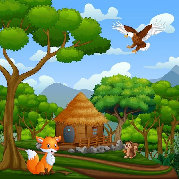 Un Chalet En Bois Et Des Animaux Au Milieu De La Forêt Vecteur Premium