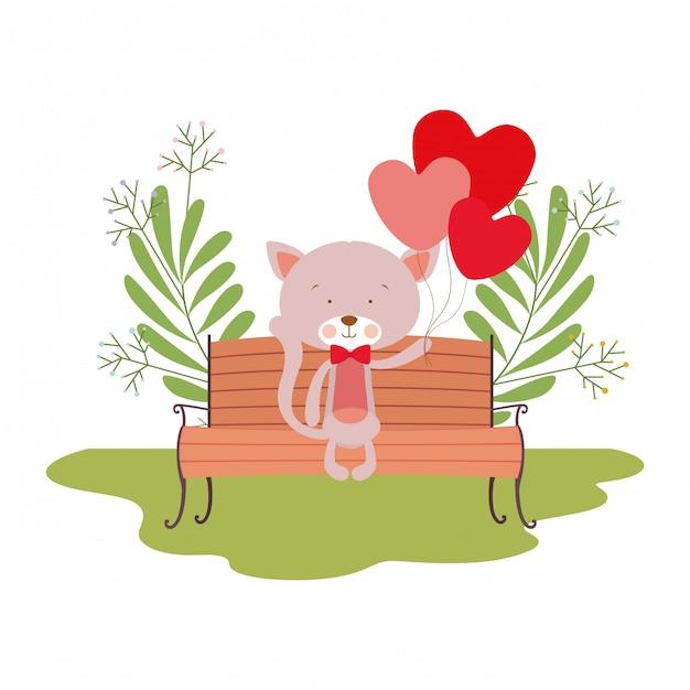 Chat mignon assis sur une chaise de parc Vecteur Premium
