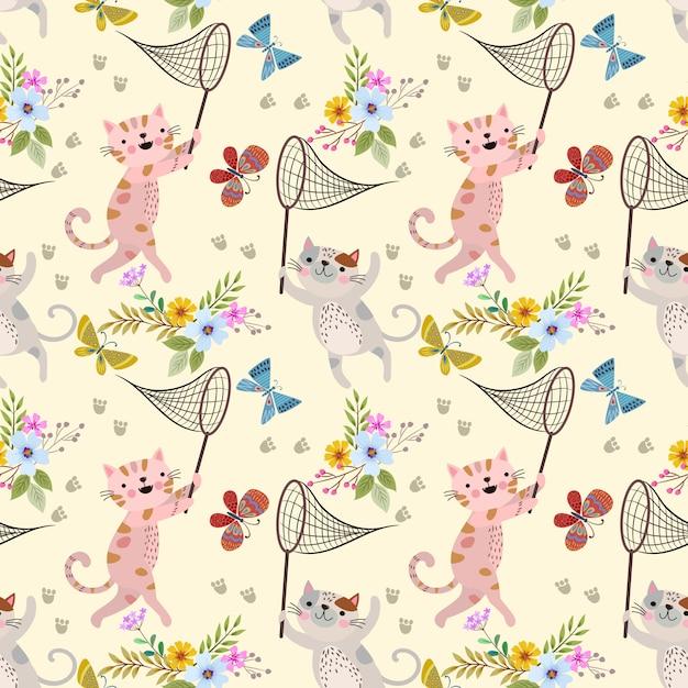 Chat mignon de bande dessinée et papillon à motif jardin de fleurs. Vecteur Premium