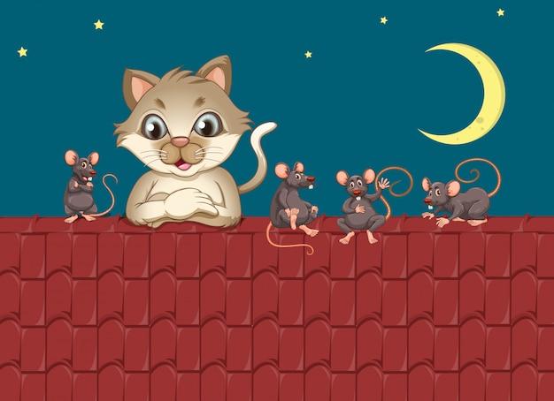 Chat une souris sur le toit Vecteur gratuit