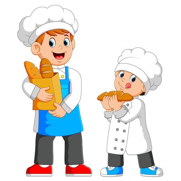 Le chef tient un sac de pain avec le garçon à côté de lui Vecteur Premium