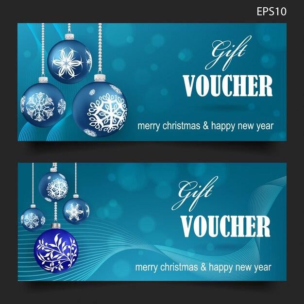 Chèque-cadeau de noël sur fond bleu Vecteur Premium