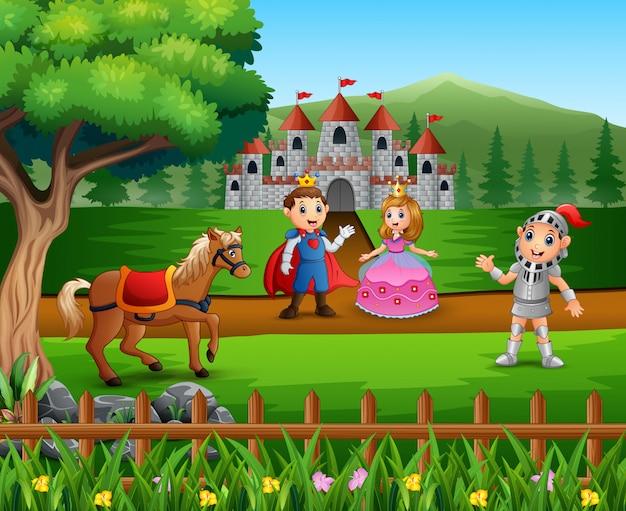 Chevalier avec couple princesse et prince dans la cour du château Vecteur Premium