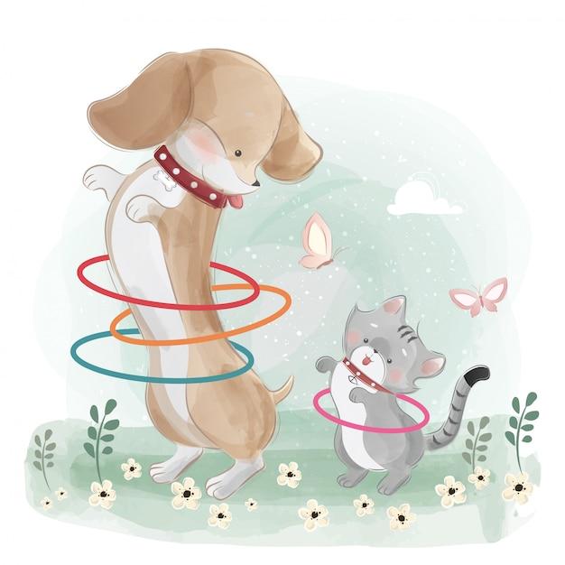 Un chien de saucisse jouant du hula hop avec le petit chaton Vecteur Premium
