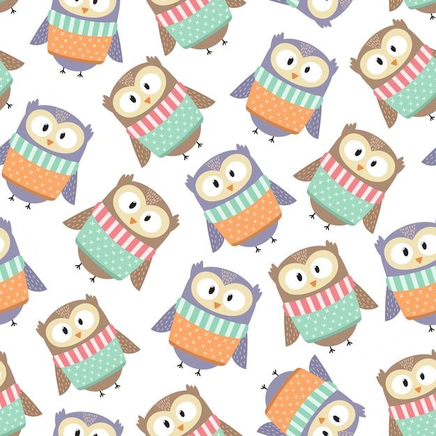 Chouettes mignons dans le modèle sans couture de vêtements hiver. illustration vectorielle Vecteur Premium