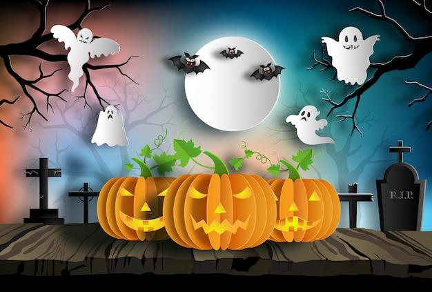 Citrouilles sur bois la nuit avec des fantômes et des chauves-souris sur le fond. Vecteur Premium