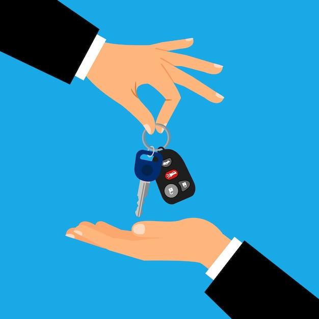 Clés de voiture avec les mains des hommes à plat Vecteur Premium