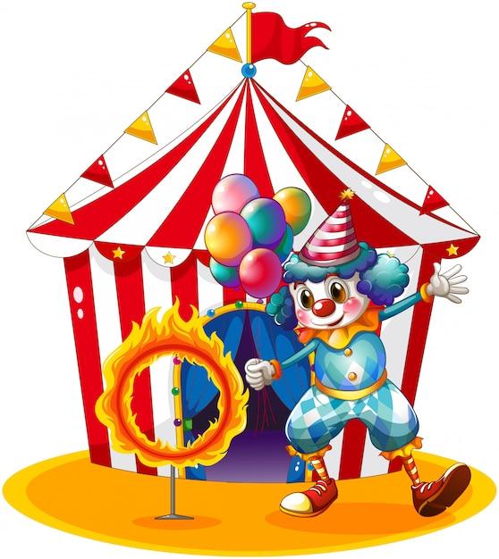 Un Clown Tenant Des Ballons Près De L'anneau De Feu Vecteur Premium