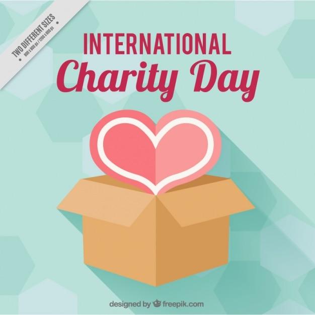 Coeur avec une boîte pour la journée internationale de la charité Vecteur gratuit
