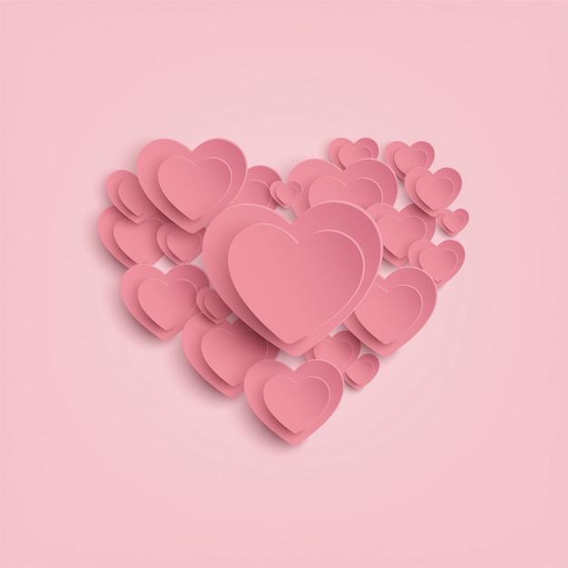 Coeur de papier sur fond rose Vecteur Premium