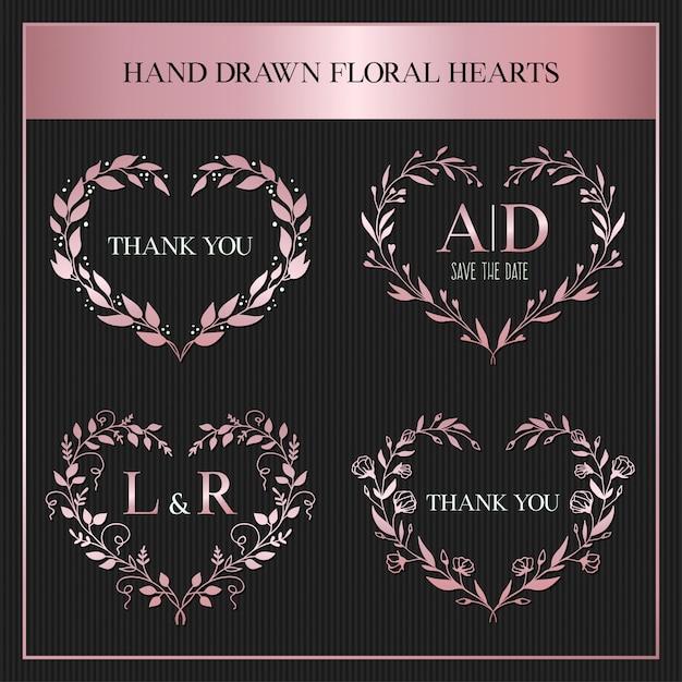Coeurs floraux dessinés à la main Vecteur Premium