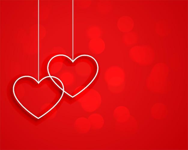 Coeurs Suspendus De Style Minimal Sur Fond Rouge Vecteur gratuit