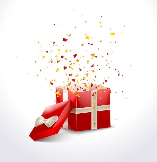 Coffret rouge ouvert avec ruban et confettis volants Vecteur Premium