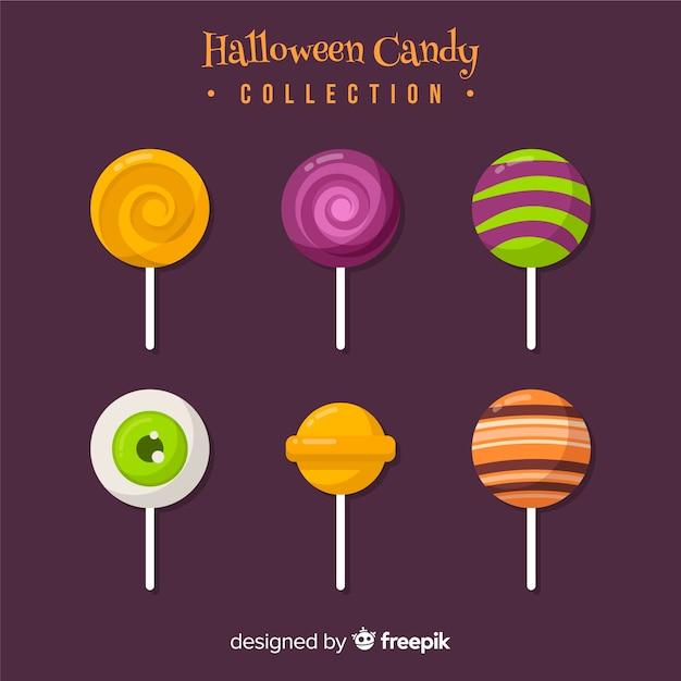 Collection de bonbons colorés d'halloween avec un design plat Vecteur gratuit
