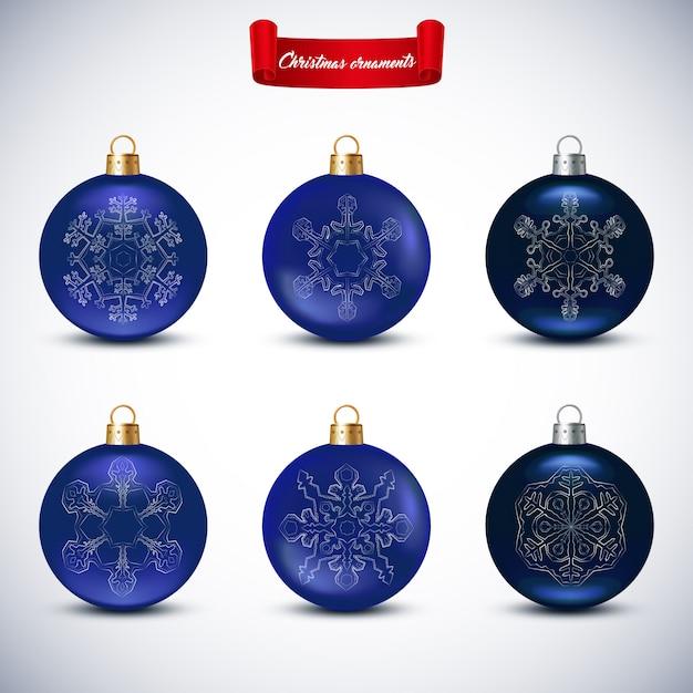 Collection de boules de noël bleues sur blanc Vecteur Premium