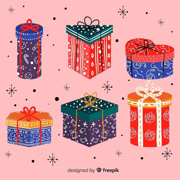 Collection de cadeaux de noël dessinés à la main Vecteur gratuit