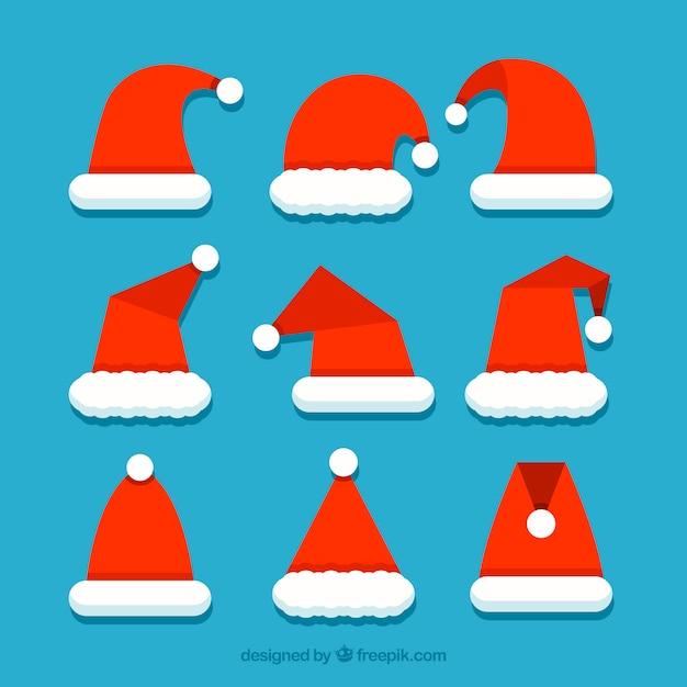 Collection De Chapeau De Père Noël Au Design Plat Vecteur gratuit