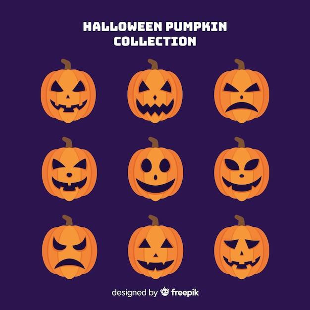 Collection de citrouilles d'halloween dessinés à la main sur fond violet Vecteur gratuit