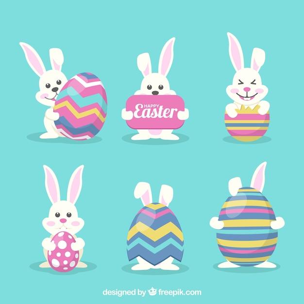 Collection de lapin de Pâques drôle avec des oeufs Vecteur gratuit