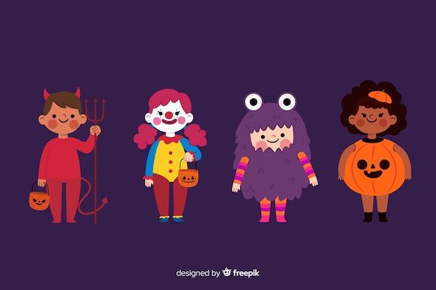 Collection d'enfant halloween plat sur fond violet Vecteur gratuit