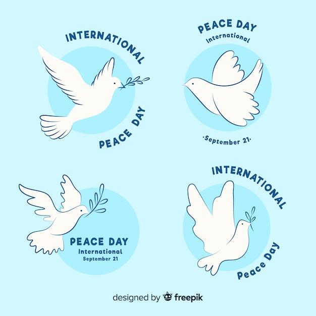 Collection d'étiquettes de jour de la paix dessinés à la main Vecteur gratuit