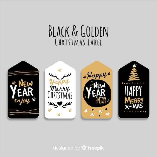 Collection d'étiquettes de noël noir et or de quatre Vecteur gratuit