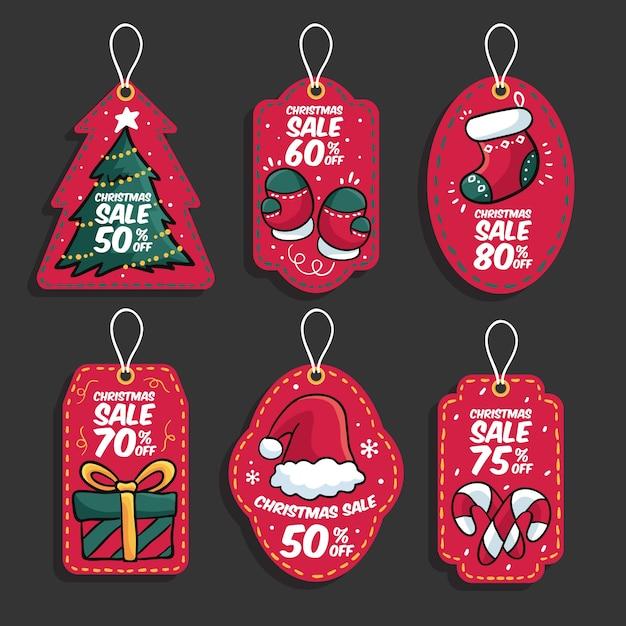Collection D'étiquettes De Vente De Noël Dessinées à La Main Vecteur gratuit