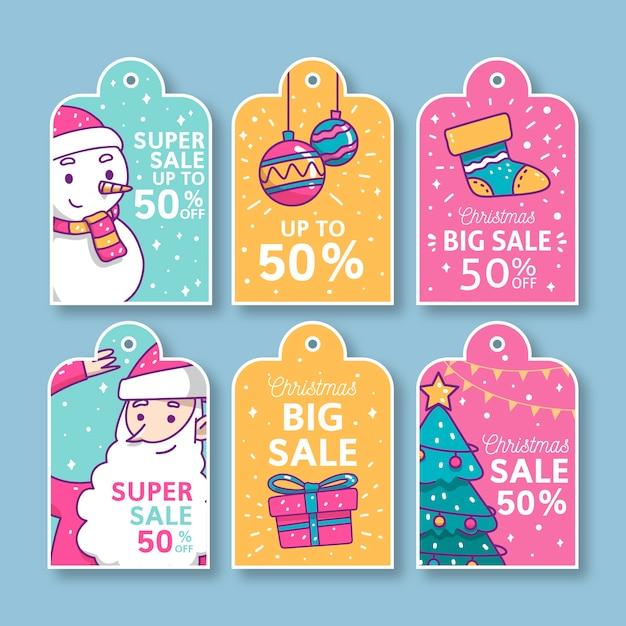 Collection D'étiquettes De Vente De Noël Dessinés à La Main Vecteur gratuit