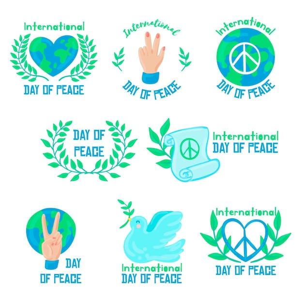 Collection D'insignes De La Journée Internationale De La Paix Dessinés à La Main Vecteur gratuit