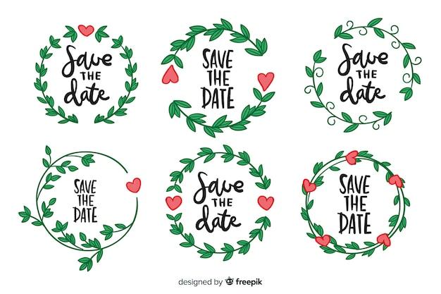 Collection d'insignes de mariage floral dessinés à la main Vecteur gratuit
