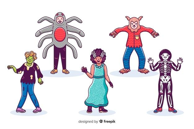 Collection de kid halloween dessinés à la main sur une surface blanche Vecteur gratuit