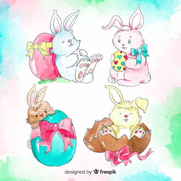 Collection de lapin de pâques dessinés à la main Vecteur gratuit