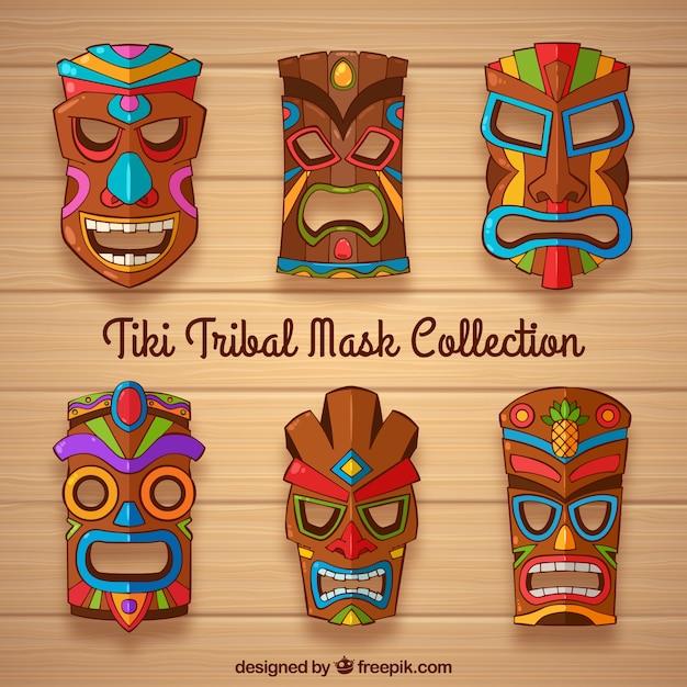 Collection de masque tiki avec des détails colorés Vecteur gratuit