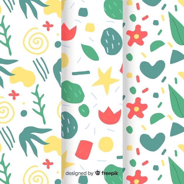 Collection de motifs abstraits dessinés à la main avec des plantes Vecteur gratuit