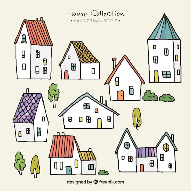 Collection De Petites Maisons Dessinés à La Main Vecteur gratuit