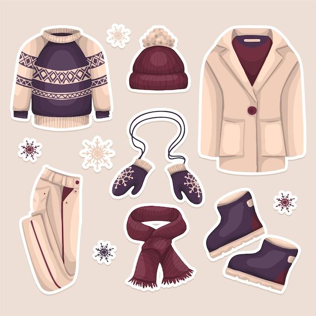 Collection De Vêtements D'hiver Dessinés à La Main Vecteur gratuit