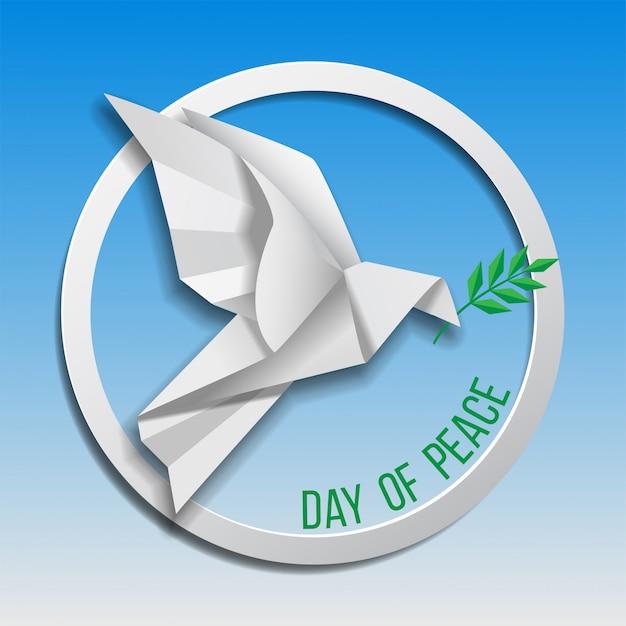 Colombe De La Paix Avec Une Branche D'olivier Volant Sur Fond Bleu. Journée Internationale De La Paix. Origami Papier. Vecteur Premium