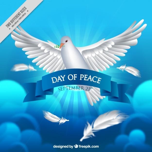 Colombe réaliste pour la journée de la paix sur fond bleu Vecteur gratuit