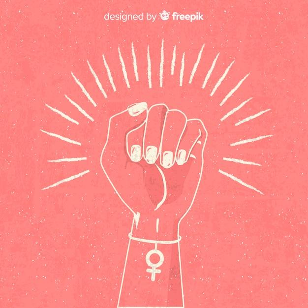 Composition du féminisme avec un poing dessiné à la main Vecteur gratuit